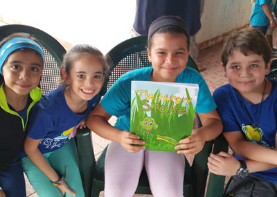 School Children in Roatan Love the Hungry Snake Book