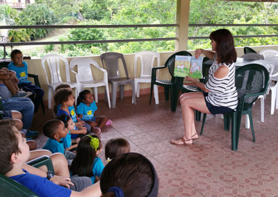 Suzanne and children at a school in Honduras